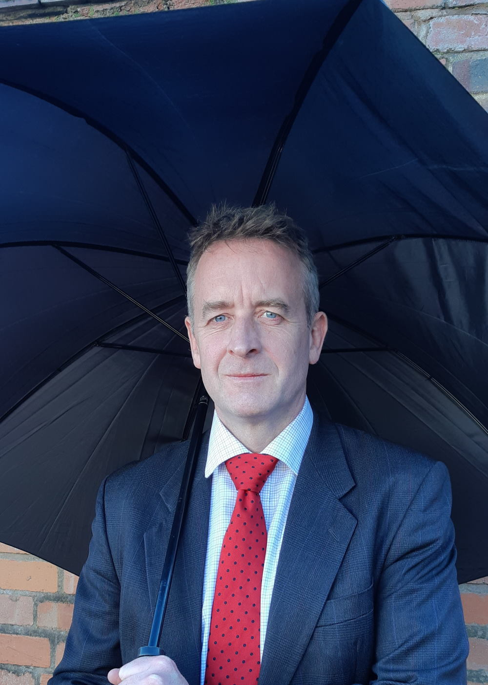 Duncan Sutcliffe under an umbrella